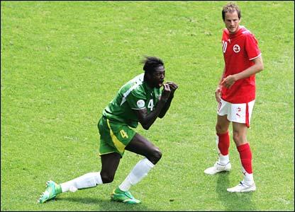 Togo's Emmanuel Adebayor and Patrick Mueller