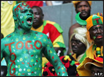 A Togolese fan covered in paint