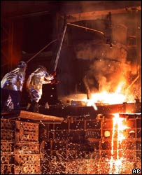 Molten steel from the World Trade Center is poured into moulds for the USS New York at a foundry in Amite, LA, in September 2003