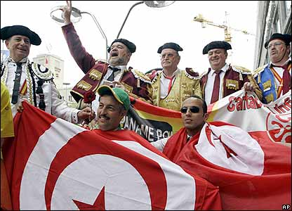 Spain and Tunisia fans pose for pictures ahead of the match