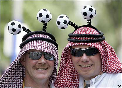 A couple of German fans looks forward to supporting Saudi Arabia