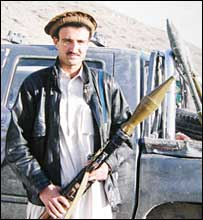 Hayatullah Khan posing with RPG in Afghanistan