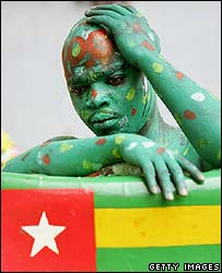 A dejected fan after Togo slump to a 2-0 loss and a World Cup exit