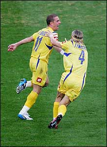 Rebrov celebrates his superb 36th-minute goal with Anatoli Tymoschuk