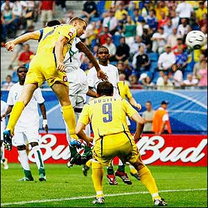 Andriy Shevchenko powerfully heads Ukraine into a 3-0 lead