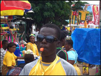 Togolese fan with a whistle