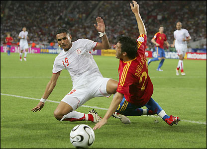 David Villa is brought down by Anis Ayari 