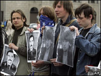 "Belarus opposition supporters holding portraits of ""disappeared"" protesters (AP)"