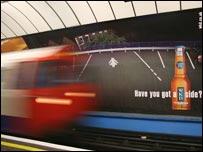 Traditional advertisement on platform wall