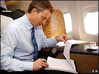 Tony Blair at work on a plane