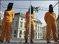 Austrian Greens activists dress up as Guantanamo Bay detainees in front of the federal chancellery in Vienna