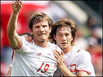 Bartosz Bosacki (left) is congratulated by his team-mate Polish midfielder Miroslaw Szymkowiak