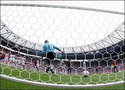 Poland keeper Artur Boruc fails to save Ronald Gomez's free-kick