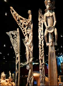 Funerary poles from Papua New Guinea are displayed