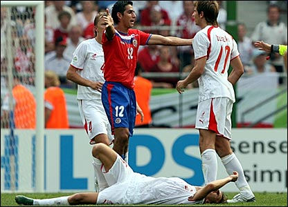 Costa Rica's Leonardo Gonzalez (left) squares up to Poland's Bartosz Bosacki