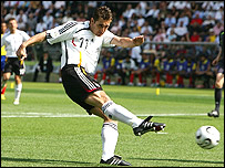 Miroslav Klose hammers home the opener for Germany against Ecuador
