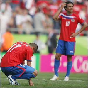 Costa Rican defender Gabriel Badilla and midfielder Walter Centeno look dejected at the end of the World Cup