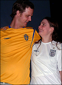 Married couple supporting Sweden and England respectively