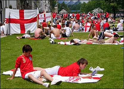 England fans dominate the banks of the river Rhine