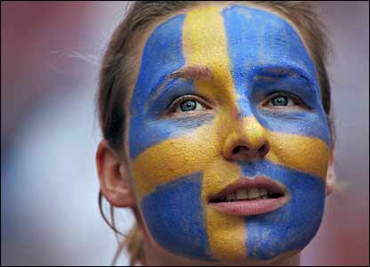 A Swedish fan sports a painted face