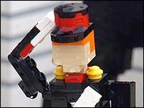 A Lego figure, saluting