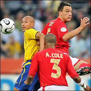 John Terry clears the ball from Sweden's Henrik Larsson
