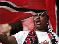 Trinidad and Tobago supporter with a flag