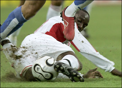 Dwight Yorke gets in a tackle