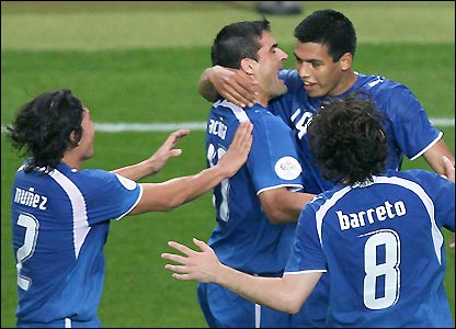 Roberto Acuna is congratulated after seeing his free-kick converted