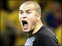 England goalkeeper Paul Robinson rallies his defence against Sweden