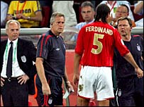 An injured Rio Ferdinand is forced to come off against Sweden