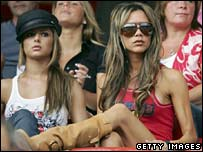 Victoria Beckham sits in the crowd watching the English football team play