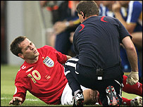 Michael Owen in agony after injuring his knee