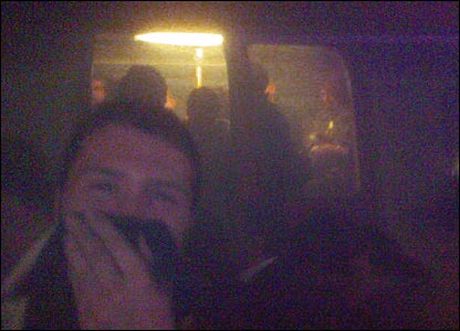 Adam Stacey exiting the bombed Piccadilly line train with sock over his mouth