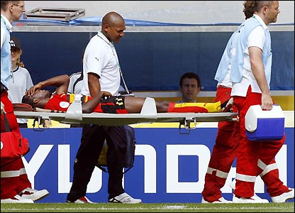 Angola's Mateus is stretchered off