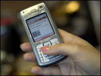 A mobile phone showing the BBC News website