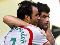 Iran's goalscorer Sohrab Bakhtiarizadeh (left)