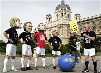 Giant puppets represent German Chancellor Angela Merkel, UK PM Tony Blair, US President George Bush and French President Jacques Chirac dressed in football kits in Vienna