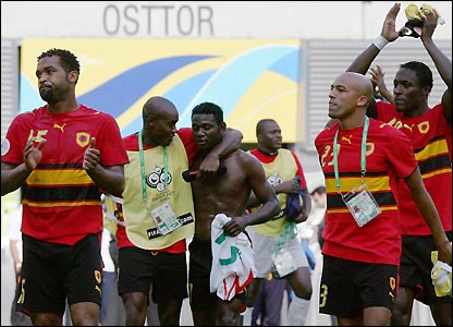 Angola's players salute their fans