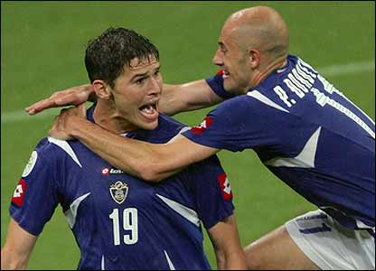 Zigic is mobbed by Predrag Djordjevic