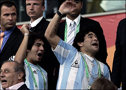 Diego Maradona (right) cheers on Argentina