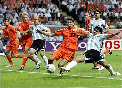 Holland's Khalid Boulahrouz (second right) tackles Tevez