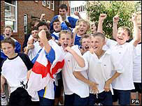 Children from Mayville High School in Portsmouth celebrate after hearing that they will now be going to the next England game
