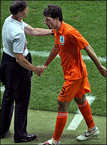 Ruud van Nistlerooy is hauled off by Holland coach Marco van Basten (left)
