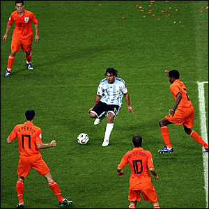 The Holland defence closes in on Carlos Tevez