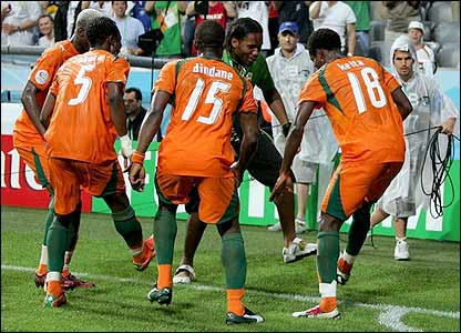 Didier Drogba leads the celebrations from the touchline