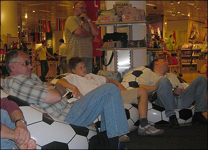 Men asleep in a Cologne department store in front of the football