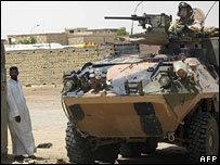 An Australian soldier drives a tank in Samawa on 21 May 2005