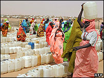 Displaced Sudanese women queue for water at a camp near Al-Fasher, capital of Darfur