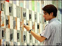 Man looking at mobile phone in China